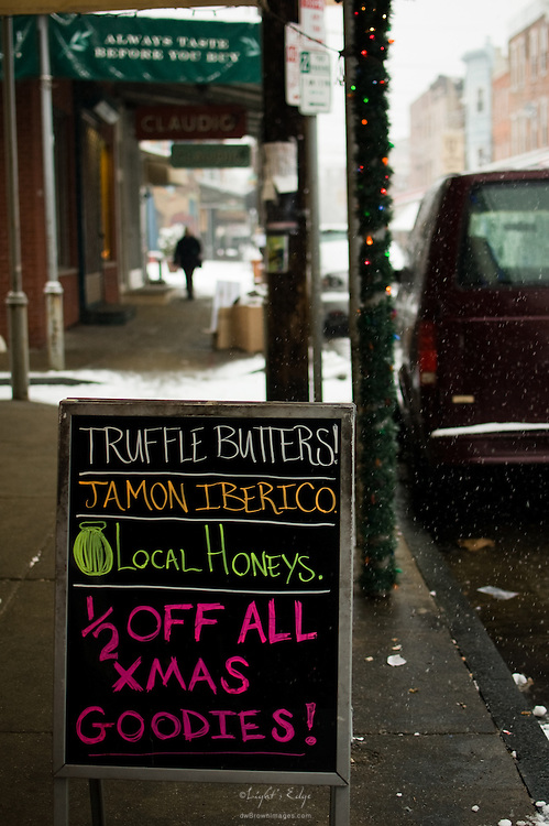 A sign on the sidewalk in front of DiBruno Brothers was about the brightess thing I saw on that cold, snowy, early morning in Philly's Italian Market.
