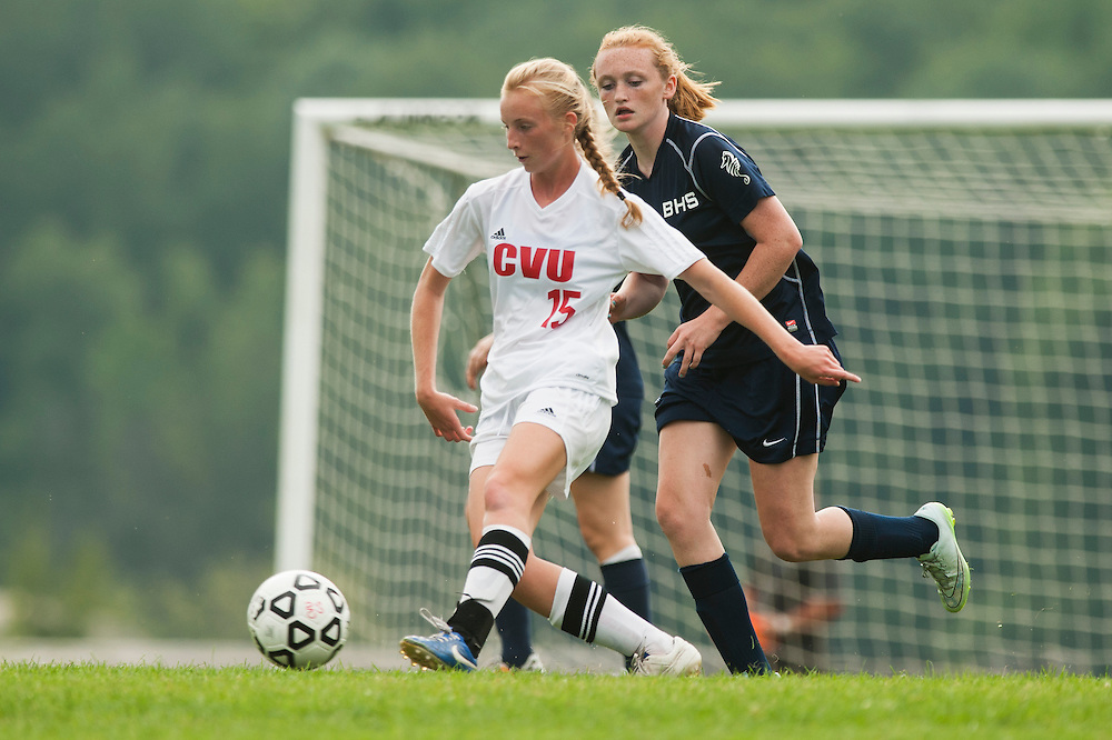 CVU's Sierra Morton (15) kicks the ball down the field during the girls varsity soccer game between the Burlington Seahorses and the Champlain Valley Union Redhawks at CVU High School on Tuesday afternoon September 8, 2015 in Hinesburg. (BRIAN JENKINS/for the FREE PRESS)