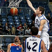 Anadolu Efes's Osman Gokhan Sirin (R) during their Turkish Basketball League match Anadolu Efes between Mersin BSB at Sinan Erdem Arena in Istanbul, Turkey, Saturday, January 14, 2012. Photo by TURKPIX