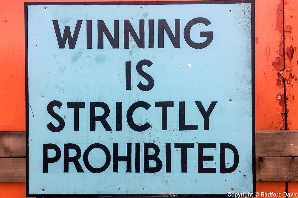 Dismaland sign. Winning prohibited. Weston-super-Mare, England