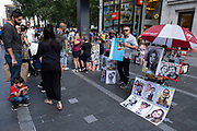 With many people and families staying in the UK for their Summer break during the school holidays, a large number of domestic tourists, who may normally have been travelling abroad, have decended on the capital to see the sights, as seen here with caricature artists in Leicester Square on 10th August 2021 in London, United Kingdom. Following the Coronavirus / Covid-19 health scare of the last two years, and with some travel restrictions still in place, more people have chosen a staycation which is a holiday spent in ones home country rather than abroad, or one spent at home and involving day trips to local attractions.