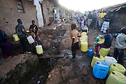 Children queue for water at a communal watering point in the Kibera slum, in Nairobi, Kenya. Kibera is Africa's largest slum, with more than 1 million inhabitants.