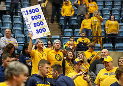 Feb 24, 2018; Morgantown, WV, USA; A West Virginia Mountaineers fan holds up a sign after beating the Iowa State Cyclones at WVU Coliseum. Mandatory Credit: Ben Queen-USA TODAY Sports