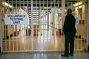 A sign at the entrance to the Voluntary Drug Testing Unit, HM Prison Wandsworth is a Category B men's prison at Wandsworth in the London Borough of Wandsworth, South West London, United Kingdom. It is operated by Her Majesty's Prison Service and is one of the largest prisons in the UK with a population over 1500 people. (photo by Andy Aitchison)