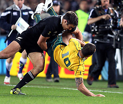 © Andrew Fosker / Seconds Left Images 2011 - New Zealand's Richard Kahui takes out Australia's Quade Cooper with a massive tackle  Australia v New Zealand - Rugby World Cup 2011 - Semi Final - Eden Park - Auckland - New Zealand - 16/10/2011 -  All rights reserved..