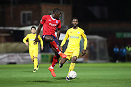 York City defender Kennedy Digie (4) clears the ball during the Vanarama National League match between York City and Chester FC at Bootham Crescent, York, England on 13 November 2018.