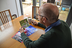 European Parliament Elections May 2019 - man reading various Green Party political party leaflet. UK May 2019