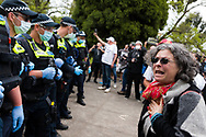 A woman pleads with police to take her side during the Melbourne Freedom Rally at The Shrine. Premier Daniel Andrews promises 'significant' easing of Stage 4 restrictions this weekend. This comes as only one new case of Coronavirus was unearthed over the past 24 hour and no deaths. (Photo by Dave Hewison/Speed Media)