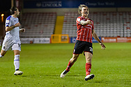 Lincoln City Midfielder Harry Anderson (26) shows his frustration during the EFL Sky Bet League 1 match between Lincoln City and Shrewsbury Town at Sincil Bank, Lincoln, United Kingdom on 15 December 2020.