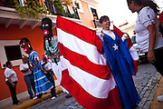 Costumed revelers parade during the Festival of San Sebastian in San Juan, Puerto Rico.