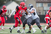 Community College of San Francisco defensive end Bobo Leota (40) goes after the College of Siskiyous quarterback at Community College of San Francisco in San Francisco, Calif., on September 10, 2016. (Stan Olszewski/Special to S.F. Examiner)
