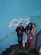 Antony Fawcett, Carla Smith and Gyunel Boateng. Marni shop opening. Sloane St. London. 25 October 2000. © Copyright Photograph by Dafydd Jones 66 Stockwell Park Rd. London SW9 0DA Tel 020 7733 0108 www.dafjones.com