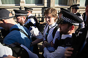 Thousands of school children went on strike and did not go to school demanding climate change action in central London March 15th 2019, Central London, United Kingdom. The strike is inspired by Greta Thunberg, a Swedish school girl who in 2018 went on school strike to make adults and lawmakers take climate change action. A young woman arrested and taken away by police. She was arrested for blocking the traffic in Parlieament Square.