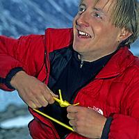 BAFFIN ISLAND, Nunavut, Canada. Jared Ogden (MR) during big wall climbing expedition to Great Sail Peak in Stewart Valley.