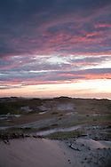The Last light of day glows over the dunes of the Provincelands area.