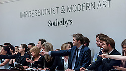 © Licensed to London News Pictures. 24/06/2015. London, UK. Sotheby's staff bid on behalf of their telephone clients. Sotheby's Impressionist & Modern art evening sale realised a total of £178.6m, the second highest total for any sale ever held in London.  Photo credit : Stephen Chung/LNP