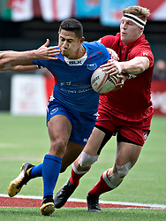 VANCOUVER, March 12, 2018  Samoa's Alatasi Tupou (L) vies with Canada's John Moonlight during the World Rugby Seven Series in Vancouver, Canada, March 11, 2018. (Credit Image: © Andrew Soong/Xinhua via ZUMA Wire)
