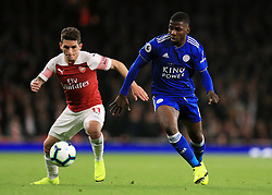 Arsenal's Lucas Torreira and Leicester City's Kelechi Iheanacho (right) battle for the ballb during the Premier League match at the Emirates Stadium, London.