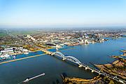 Nederland, Zuid-Holland, Gorinchem, 07-02-2018; Merwedebrug bij Gorinchem, op de grens tussen Noord-Brabant en Zuid-Holland over Boven-Merwede. Direct naast de brug bedrijventerrein Avelingen. In het kade van het programma Ruimte voor de Rivier heeft de uitwaardvergraving Avelingen plaast gevonden met als doel waterstanddaling op de Merwede bij hoogwater.<br /> Merwede bridge at border South Holland and Brabant.<br /> <br /> luchtfoto (toeslag op standard tarieven);<br /> aerial photo (additional fee required);<br /> copyright foto/photo Siebe Swart