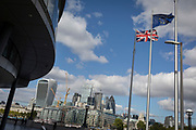 The Union Jack, the EU and a flag saying London is open fly at City Hall with the capital's financial district (aka the Square Mile) in the distance on 5th October, 2017, in London, England.