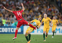 SYDNEY, Oct. 10, 2017  Tomas Rogic (C) of Australia vies with Hamid Mido (L) of Syria during the FIFA World Cup 2018 Qualifiers Asian Playoff match between Australia and Syria at Sydney Olympic Stadium in Sydney, Australia, Oct. 10, 2017. Australia won 2-1. (Credit Image: © Bai Xuefei/Xinhua via ZUMA Wire)