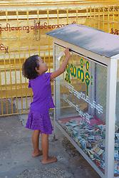Young Girl Making Donation At Lawka Nanda
