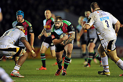 Joe Marler of Harlequins takes on the Wasps defence - Photo mandatory by-line: Patrick Khachfe/JMP - Mobile: 07966 386802 17/01/2015 - SPORT - RUGBY UNION - London - The Twickenham Stoop - Harlequins v Wasps - European Rugby Champions Cup