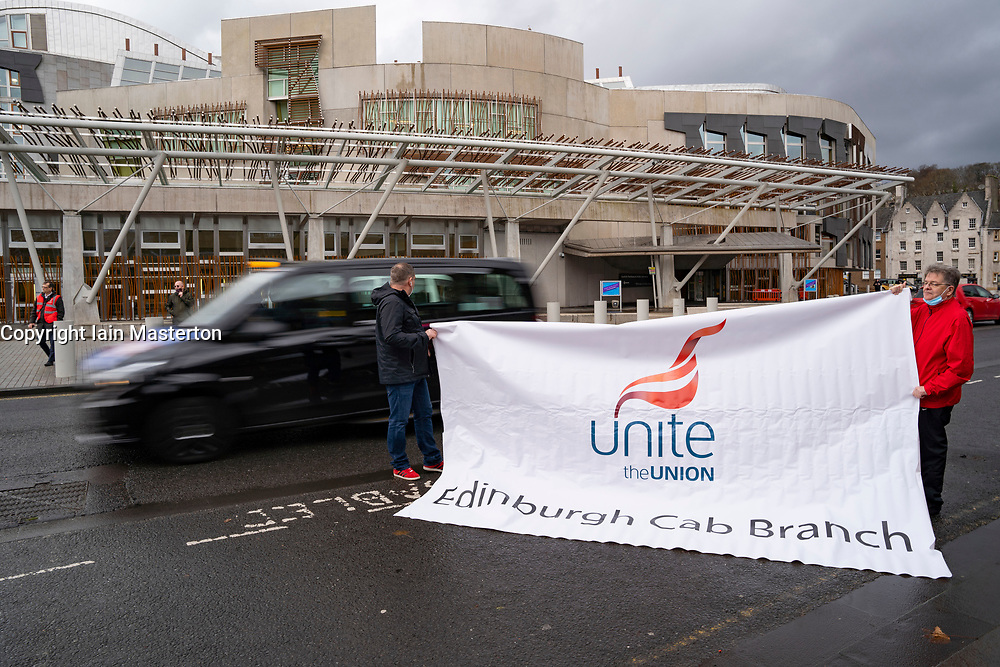 Edinburgh, Scotland, UK. 16 December 2020. Taxi drivers demonstrate outside Scottish Parliament at Holyrood. The drive by protest by black cabs was organised by the Unite union. A spokesman said the action was to raise the plight of thousands of taxi drivers who are suffering hardship during the current coronavirus pandemic and its affect on the economy. Iain Masterton/Alamy Live News