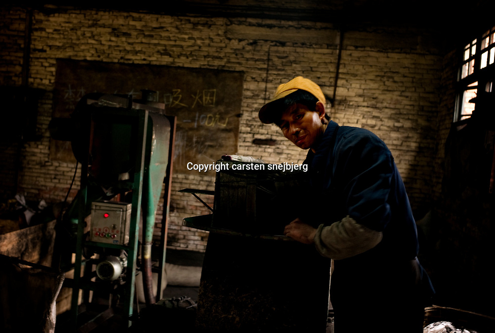 Worker at small factory in Chongqing, China, on tuesday 22. jan, 2008