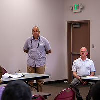 Edward Gonzales from Depauli Engineering and City Councilor Allan Landavazo listen to concerns from community members at the neighborhood meeting Thursday evening.