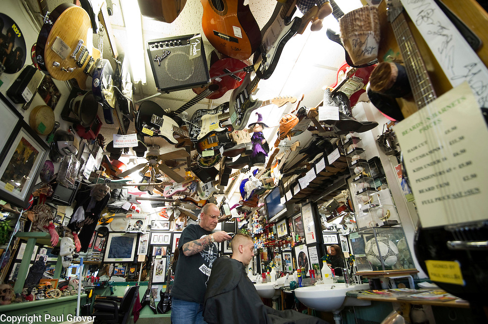 Dunstable.Beards 'n' Barnets Barbershop.Pic Shows 53 yr old Geoff Cole a rock nut who has turned his barbershop into a rock music shrine with over 200 guitars in the shop and also drumsticks and boots owned and signed by rock stars.Geoff has had the barbers set like this for 3 years and recently had movie director Luc Besson in to have a look raround