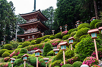 Eirinji Pagoda - Eirinji or Eirinji Jokoden Temple located in Shimo-Yugi in Hachioji Tokyo.  The temple is selected as one of Hachioji Hachiji-Hakkei 88 Scenic Places in Hachioji.   Eirinji is a temple of the Soto sect of Zen Buddhism. The main object of worship is Dakini Sonten.  Passing through the three gates of Somon, Romon and Suzakumon, you will reach the main hall. On a hill behind the main hall is the ruin of Oishi Sadahisa's old residence, as well as a magnificent dry zen garden that is rarely open to the public but can be seen from the corner of the main temple building. The temple is attributed to Oishi Sadahisa, a powerful warrior in the Warring States period 1493-1573. When Sadahisa moved to Takiyama Castle with which the temple is associated, he founded Eirinji here. Later when Tokugawa Ieyasu moved to the Kanto region, he praised the grove in the precinct of this temple.  Surrounding the temple grounds are hills planted with various types of shrubs, including azaleas that bloom in spring with color