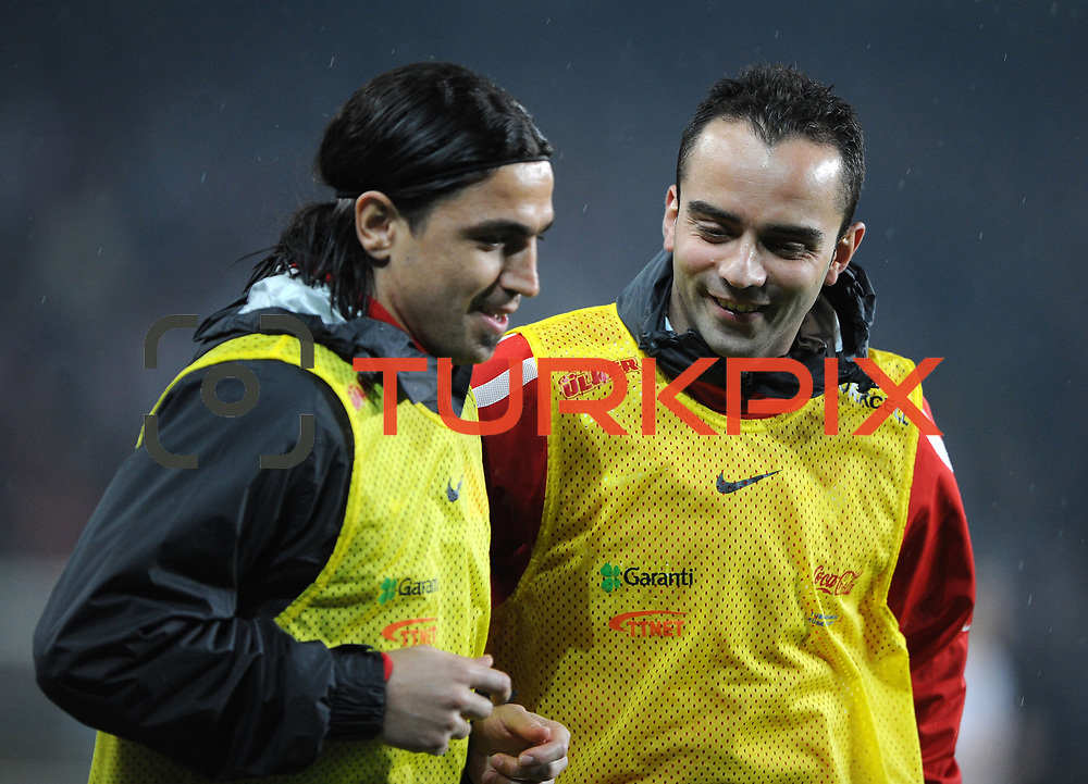 Turkey's Mehmet TOPUZ (L) and Semih SENTURK (R) during their UEFA EURO 2012 Qualifying round Group A soccer match Turkey betwen Austria at Sukru Saracoglu stadium in Istanbul March 29, 2011. Photo by TURKPIX