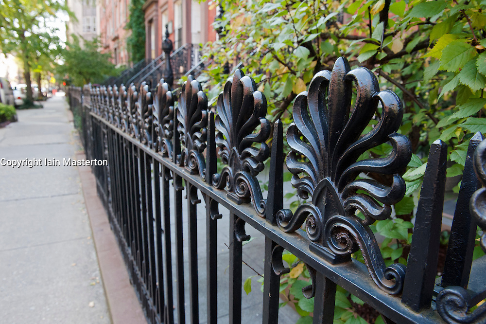 Detail of ornate iron railings on street in Chelsea district of Manhattan New York City