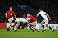 Steff Evans of Wales © is stopped by Jonathan Joseph of England. England v Wales, NatWest 6 nations 2018 championship match at Twickenham Stadium in Middlesex, England on Saturday 10th February 2018.<br /> pic by Andrew Orchard, Andrew Orchard sports photography