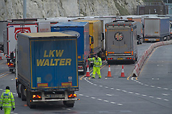 © Licensed to London News Pictures 26/12/2020.        Dover, UK. Police at the Port of Dover as lorries check in. Over 1000 lorries are left queuing on the M20 heading for Dover as Manston Airport is cleared. Emergency services and military personnel continue to tests travellers at Dover in Kent for Coronavirus before they cross the English Channel. Photo credit:Grant Falvey/LNP