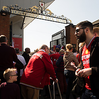 Anfield, Liverpool, UK. 15th April, 2014. On the 25th anniversary of the Hillsborough disaster members of the public pay their respects to the Hillsborough Memorial outside the Shankly Gates at Anfield Stadium.
