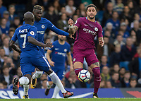Football - 2017 / 2018 Premier League - Chelsea vs Manchester City<br /> <br /> Kyle Walker (Manchester City) tries to reach the ball before Ngolo Kante (Chelsea FC) and Tiemoue Bakayoko (Chelsea FC) at Stamford Bridge <br /> <br /> COLORSPORT/DANIEL BEARHAM