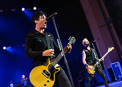© Licensed to London News Pictures. 21/08/2013. London, UK.   Green Day performing an intimate pre-Reading & Leeds Festivals warmup gig at Brixton Academy, in advance of their headline performances at the festivals this coming weekend.  In this pic - Billie Joe Armstrong (left) and Mike Dimpt (right).  Green Day is an American punk rock band formed in 1987. The band consists of lead vocalist and guitarist Billie Joe Armstrong, bassist and backing vocalist Mike Dirnt, drummer Tré Cool and guitarist and backing vocalist Jason White.  Photo credit : Richard Isaac/LNP