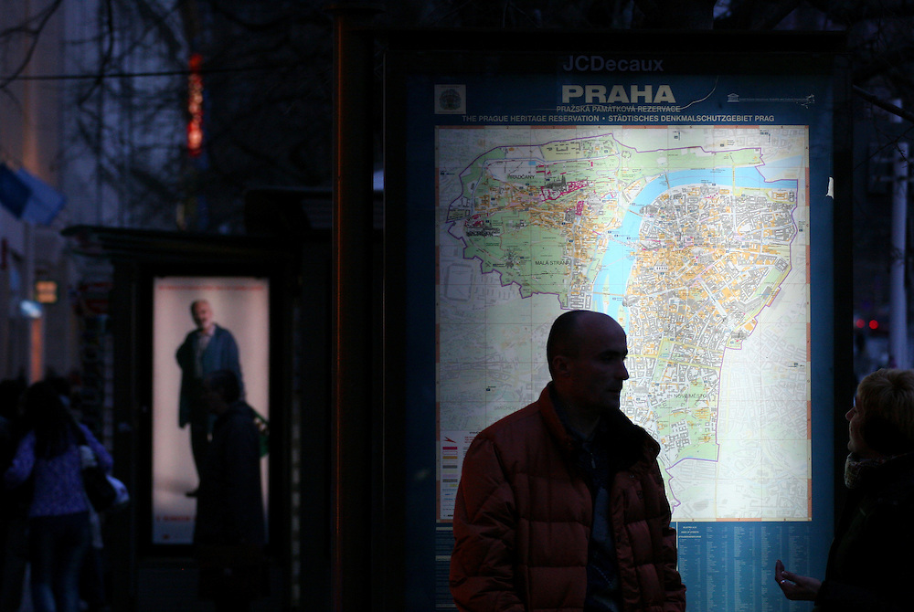 Tourists at the Prague Wenceslas Square in front of a map with the Prague Heritage Reservation.