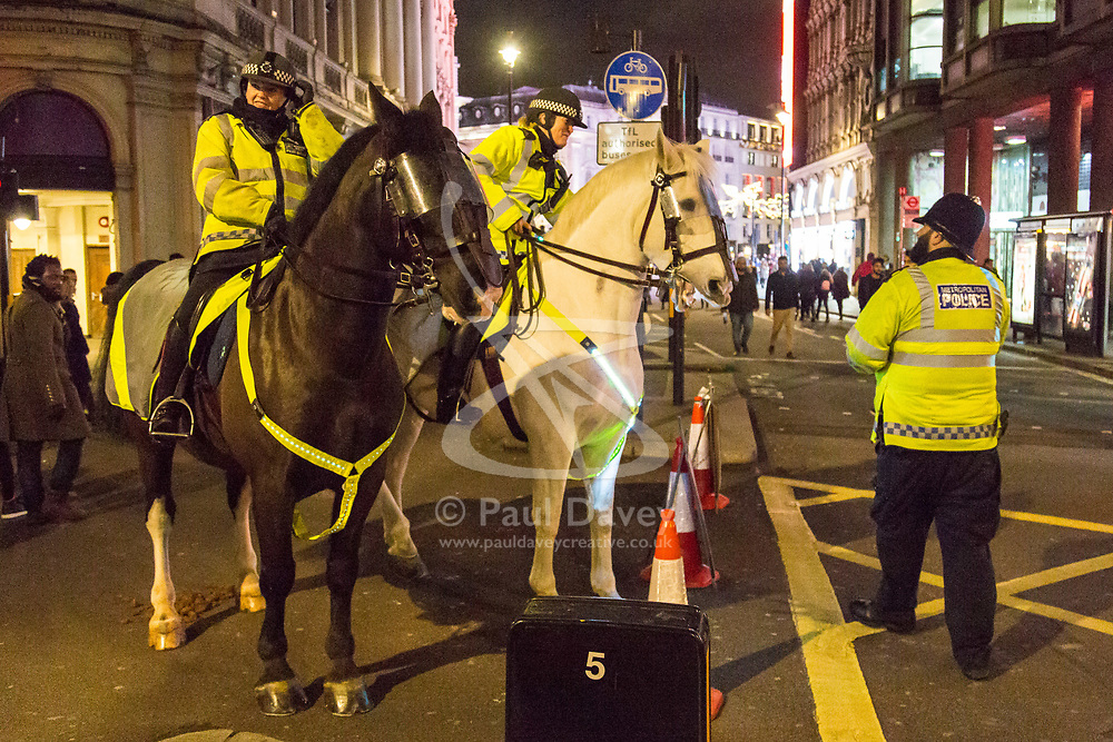 London, December 31 2017. Mounted police patrol along Shaftesbury Avenue as revellers in London's West End enjoy the build-up to New Year. © SWNS