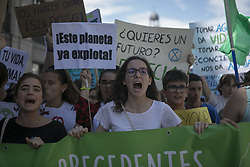 May 24, 2019 - Madrid, Madrid, Spain - Students are seen shouting slogans while holding a banner and placards during the protest..Fridays for Future movement organized a protest worldwide against climate change. (Credit Image: © Guillermo Gutierrez/SOPA Images via ZUMA Wire)