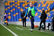 AFC Wimbledon defender Archie Proctor (25) warming up as sub during the EFL Sky Bet League 1 match between AFC Wimbledon and Lincoln City at Plough Lane, London, United Kingdom on 2 January 2021.
