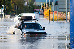 South Yorkshire flooding. Ickles Roundabout Rotherham. As Specialist rescue teams from the West Midlands Fire service rescue people from vehicles and business premises along the A6178 Sheffield Rd a four wheel drive makes its way through flood water which in places is up to chest deep<br />  Copyright Paul David Drabble<br />  07 November 2019<br />  www.pauldaviddrabble.co.uk