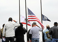 Participants salute the flag during a Memorial Day ceremony at the Monterey County Vietnam Veterans Memorial in Salinas.