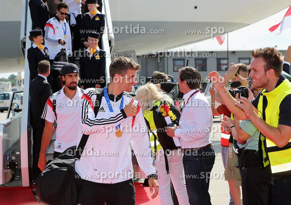 15.07.2014, Flughafen Tegel, Berlin, GER, FIFA WM, Empfang der Weltmeister in Deutschland, Finale, im Bild Thomas Mueller (GER), dahinter Sami Khedira (GER) // during Celebration of Team Germany for Champion of the FIFA Worldcup Brazil 2014 at the Flughafen Tegel in Berlin, Germany on 2014/07/15. EXPA Pictures © 2014, PhotoCredit: EXPA/ Eibner-Pressefoto/ Pool<br /> <br /> *****ATTENTION - OUT of GER*****