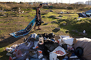 A homeless woman named Eve finds treasures in trash at her camp on Nov. 17, 2008.