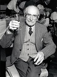 Portrait of an elderly man having a glass of wine at Christmas day centre meal, Nottingham, UK. December 1990
