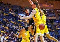 Feb 18, 2019; Morgantown, WV, USA; Kansas State Wildcats guard Mike McGuirl (0) passes the ball during the first half against the West Virginia Mountaineers at WVU Coliseum. Mandatory Credit: Ben Queen-USA TODAY Sports