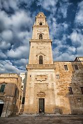 Il Campanile del Duomo venne costruito tra il 1661 e il 1682 dall'architetto leccese Giuseppe Zimbalo su incarico dell'allora vescovo della città, Luigi Pappacoda. Venne edificato in sostituzione di quello normanno, voluto da Goffredo d'Altavilla, crollato agli inizi del Seicento..La torre campanaria ha una forma quadrata e risulta essere formata da cinque piani rastremati, l'ultimo dei quali è sormontato da una cupola ottagonale maiolicata, sulla quale è posta una statua in ferro raffigurante Sant'Oronzo. Gli ultimi quattro piani presentano quattro monofore alle quali le antistanti balaustre conferiscono la pittoresca funzione di lunghi balconi. Impreziosiscono il campanile alcune epigrafi latine le quali, incise su targhe posizionate sopra le monofore, furono dettate dal letterato leccese Giovanni Camillo Palma. Ha un'altezza di 72 metri, e dalla sua sommità è possibile ammirare il mare Adriatico e nei giorni particolarmente limpidi anche le montagne dell'Albania..
